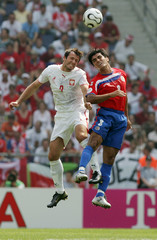 Poland's Zurawski jumps for the ball with Costa Rica's Solis in Hanover