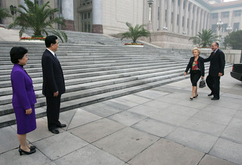 Visiting French President Jacques Chirac and his wife Bernadette arrive to meet with Chinese ...