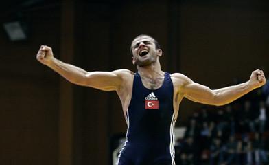 Turkey's Ayvazoglu celebrates his win over Armenia's Adikyan during the men's 66kg Greco-Roman wrestling finals at the European Wrestling Championship in Sofia