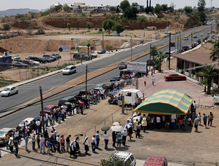 Voters wait in line to cast their vote in Mexico's presidential election at this polling station in Nogales