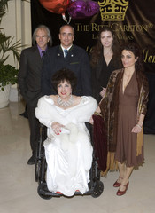 Actress Elizabeth Taylor and her children pose as they arrive for her birthday party in Lake Las Vegas, Henderson