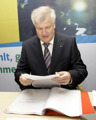 Bavarian state premier and leader of the CSU Seehofer awaits start of board meeting in Munich