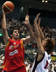 Spain's Mumbru shots past Japan's Amino during their world basketball championships in Hiroshima