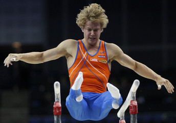 Epke Zonderland of the Netherlands performs his routine on the parallel bars during the qualifying round of the World Gymnastic Championships at the O2 Arena in London