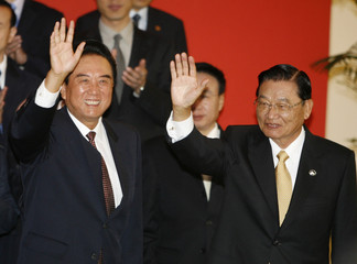 Taiwan's Chiang and China's Chen wave after signing agreement in Beijing
