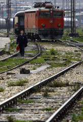 A worker walks along a track at the main railway station in Belgrade