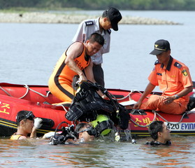 South Korean firemen conduct a search for missing soldiers in the Imjin river near the demilitarized..
