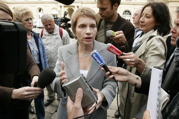 Parisot, head of the French employer's body MEDEF speaks to media as she arrives to attend a debate at the French Senate in Paris