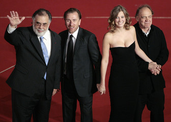 U.S. movie director Coppola, flanked by actors Roth, Lara and Ganz, waves as he arrives at the Rome International Film Festival