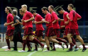 Belgium's international soccer players run during a training session during a training session in ...