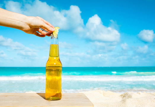 Bottle of cold beer on the beach.