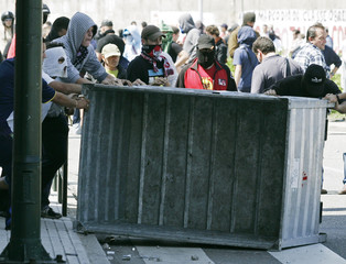 Metal workers clash with police during a protest in Vigo
