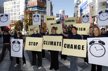 Student activists from the U.S. hold placards demanding world leaders to take action to stop climate change in Tokyo