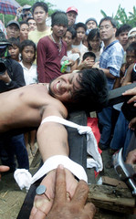 FILIPINO PENITENT NAILED TO CROSS IN NORTHERN PHILIPPINES.