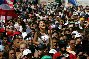 A Miami resident yells a slogan during a show in the Calle Ocho Festival in Miami.