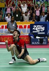 CHINA'S BAO CHUN LAI REACT AFTER BEATING DENMARK'S KENNETH JONASSEN IN JAKARTA.
