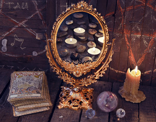 Magic mirror with Tarot cards and mystic objects. Divination rite