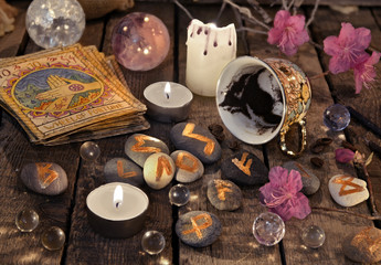 Mystic still life with coffee grounds, tarot cards and sone runes reading. Divination rite