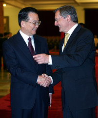 Chinese Premier Wen Jiabao greets visiting Austrian Chancellor Wolfgang Schuessel in Beijing.