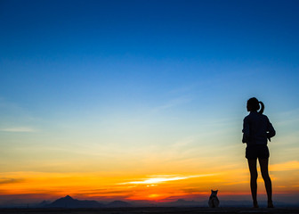 woman with sunset silhouette