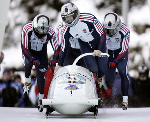 Russia's Zoubkov, Golubev, Selivestrov and Voevoda push their sled at FIBT Bobsleigh World Cup in Igls