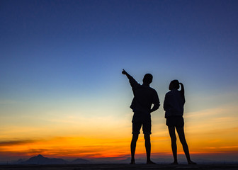 Silhouette of couple love outside sunset