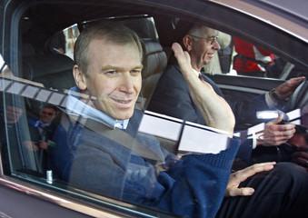 Belgium's Prime Minister-in-waiting Yves Leterme leaves the Leuven's university hospital