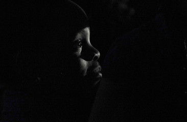 A child waits outside the tent before performing at the Redemption Camp in Floyd