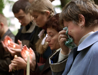 BELARUSSIAN WOMEN WEEP OUTSIDE THE AMERICAN EMBASSY IN MINSK.