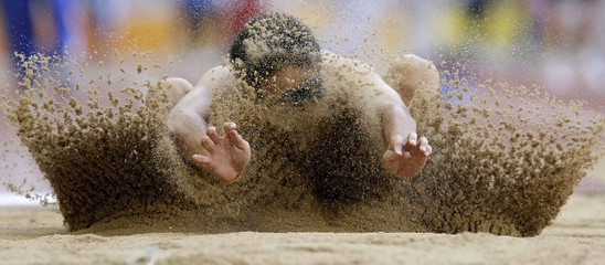 Thailand's Punthong competes in the men's long jump F11 final during the Beijing 2008 Paralympic Games