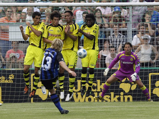 Weiden's Okle takes a free kick against Borussia Dortmund during their German soccer cup match in Weiden
