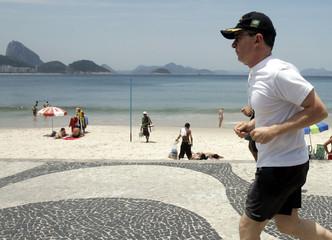 Colombian President Uribe jogs along Copacabana beach in Rio de Janeiro.