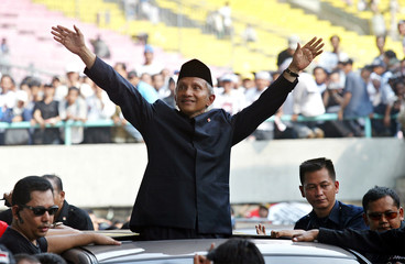 INDONESIAN PRESIDENTIAL CANDIDATE AMIEN RAIS WAVES TO SUPPORTERS IN JAKARTA.