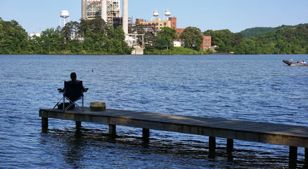 Fishing on a lake dock.