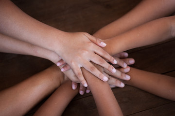 Family and children holding hands together