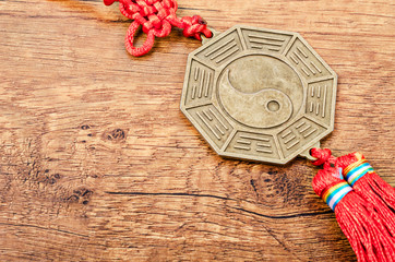 Close up metal sign of Yin Yang coin.