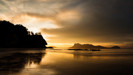 Golden light at beach in Borneo Bako national park Malaysia