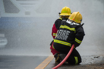firefighter control the fire on the road