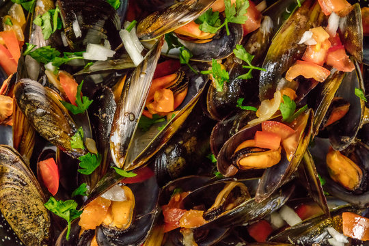 Closeup of marinara mussels, shot from above
