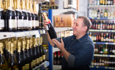 Portrait of man buying a wine