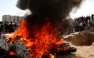 Drugs that were seized by Palestinian security forces loyal to Hamas, are burnt in Gaza City