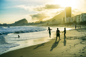 Young Brazilians play a casual round of keepy-uppy in a circle on Copacabana Beach in Rio de Janeiro, Brazil