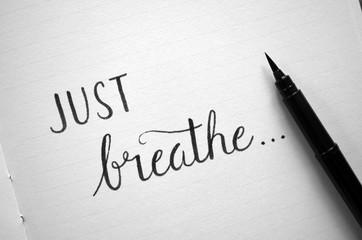 JUST BREATHE... handwritten on notepad