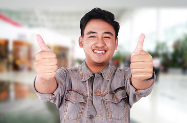 Young Asian Guy Showing Two Thumbs Up