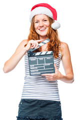 Happy actress with beater movie on white background in christmas hat