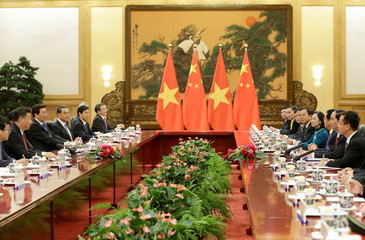 Vietnam's President Tran Dai Quang and China's President Xi Jinping attend a meeting in Beijing
