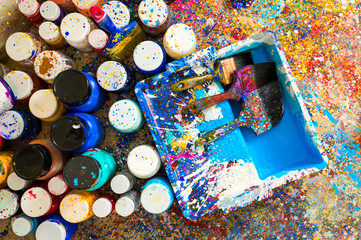 Cans of paint and brush in a pallet