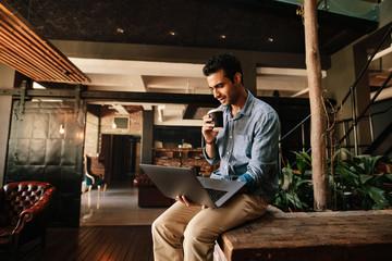 Executive using laptop during coffee break
