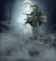Gothic Gravestone in Graveyard at Full Moon