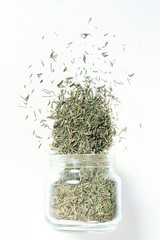 Thyme in glass jar. Heap. Isolated on white. Top view
